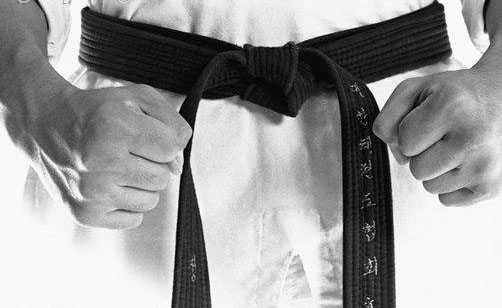 What does it mean to achieve black belt?