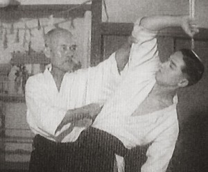 Morihei Ueshiba applying a strike to the ribs of Gozo Shioda